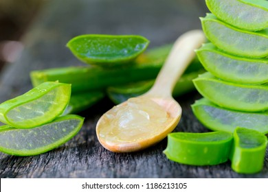 Aloe vera on wooden spoon on wooden table There are many useful herbs.