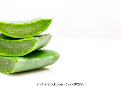 Aloe vera in pieces in front of white background