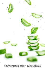 Aloe Vera slices stacked with water splash over white background