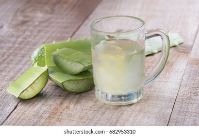 Aloevera fresh leaf  and juice on a wooden background