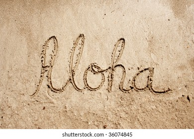 Aloha handwritten in sand for natural, symbol,tourism or conceptual designs