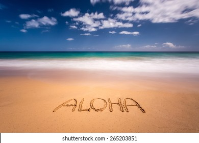 Aloha written in the sand on the beach of Kapaa, Kauai, Hawaii