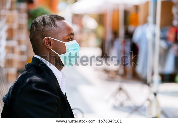 Alone african businessman with medical mask for protect from corona virus or covid-19