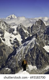 Alone, beginning the downward climb into space. Lonely climb down the ridge on Mont Blanc (Aiguille du Midi).