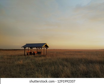 Alone bench at sunset