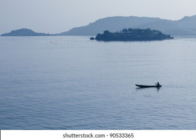 Alone boat with fisherman in sea