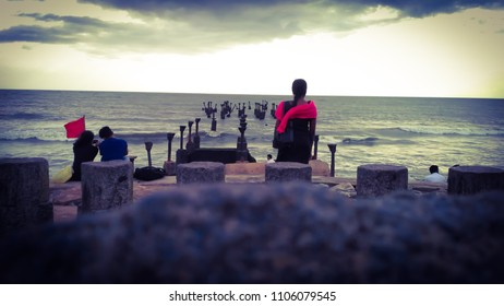 Alone - Break up pic, A single women staring at the sea in a sad mood when a couple enjoying their love.