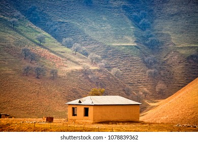 Alone building against landscapes of Middle Asia (Uzbekistan)