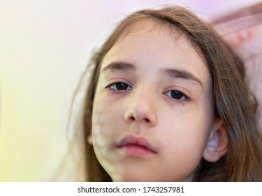 An alone girl gets bored at home. The childrens have not been able to leave the house for a long time due to coronavirus restrictions - Shutterstock ID 1743257981