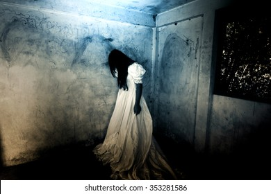 Alone in Horror Night,Ghost in Haunted House,Mysterious Woman in White Dress Standing in Abandon Building,Horror Background For Halloween Concept and Book Cover Ideas