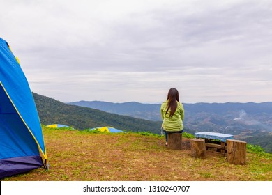 alone lady feel relax and look out mountain view in camping