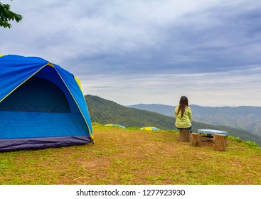 alone lady sit on seat and look out mountain view in Thai land a