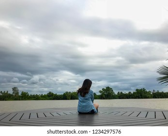 alone lady sit on Waterfront