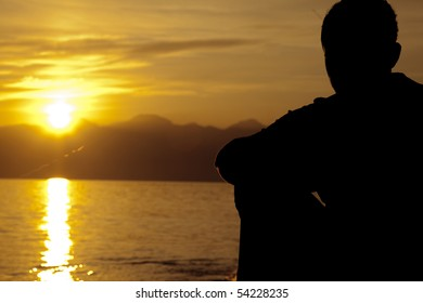 Alone Man drinking on the beach