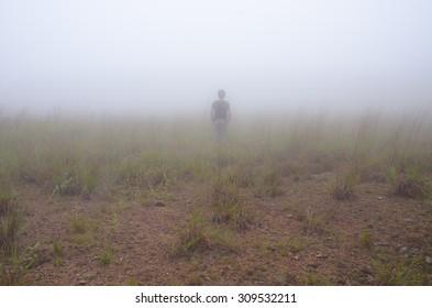 Alone man in fog