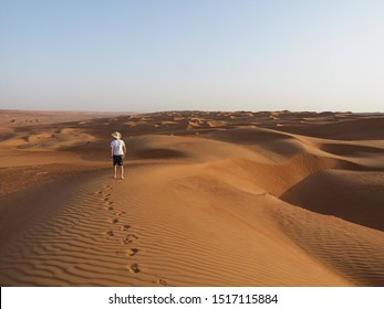 Alone man in Oman desert. background desert and wallpaper. Copy space