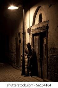 Alone man smoke under the streetlight