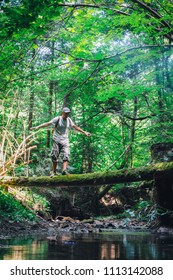 Alone man in wild forest. Travel and adventure concept. Landscape photography