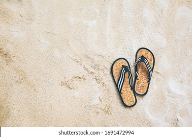 Alone on the beach, self quarantine, Maldives, lonely pair of flipflops on sand Maldives background, loneliness, isolation