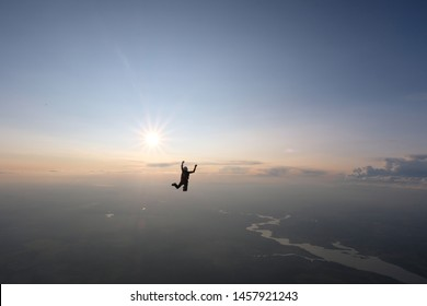 Alone skydiver is falling in the sky.