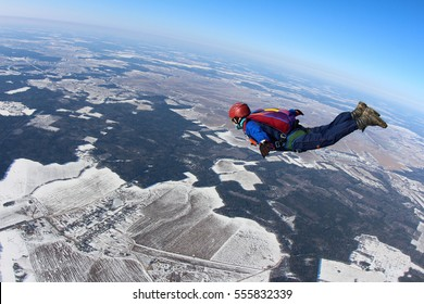 Alone skydiver is in the free fall.