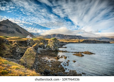 Alone standing house in fishing village of Arnarstapi in Iceland. Panoramic view