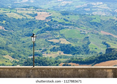 Alone street lamp with a nature landscape.