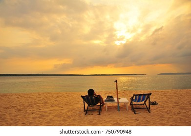 Alone Woman Relax at The Peaceful Beach
