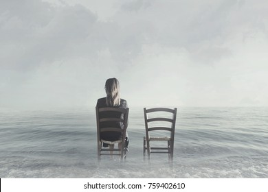 alone woman sitting next to her lover's empty chair