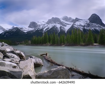 Along the Banks of Turquoise Bow River with Mountain Backdrop