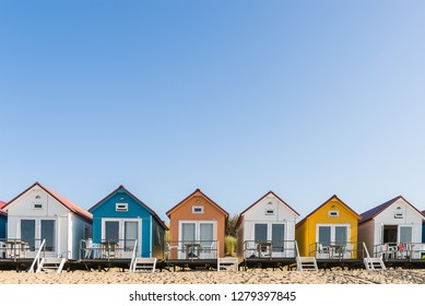 Along the beach of The Netherlands you can find lots of colored beach houses. They are occupied by tourists who stay there for the weekend or spen their holiday there