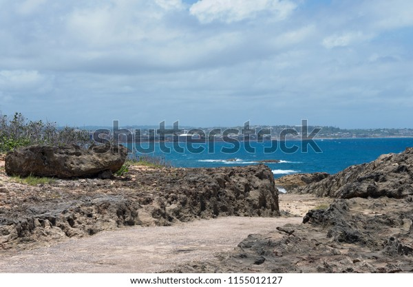 along the shore at punta marillos arecibo puerto rico near lighthouse historical park with view across harbor