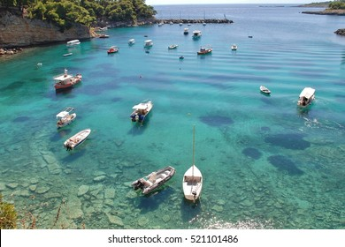 ALONISSOS, GREECE - SEPTEMBER 23, 2012: Small boats moored in the harbour at Votsi on the Greek island of Alonissos. The fishing village lies to the North West of Patitiri, capital of the island.