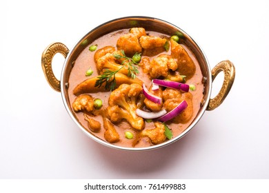 Aloo Gobi mutter is a famous Indian curry dish with potatoes and cauliflower and green peas, selective focus