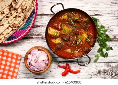 Aloo Gosht - meat curry in North Indian and Pakistani cuisine.consists potatoes aloo cooked with meat gosht