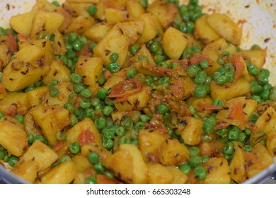Aloo Matar Indian dry curry ( potato and green peas Indian veg.)
