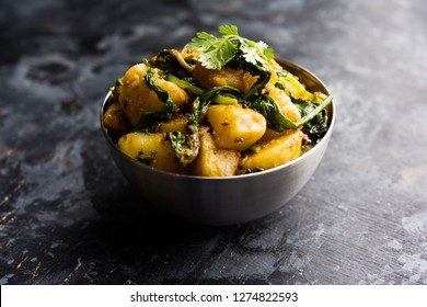 Aloo Palak sabzi - Potato cooked with spinach with added spices. a healthy Indian main course recipe. Served in a bowl, selective focus
