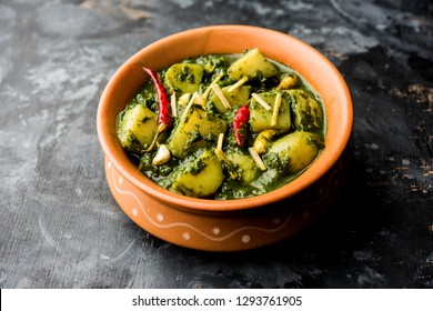 Aloo Palak sabzi or Spinach Potatoes curry served in a bowl. Popular Indian healthy recipe. Selective focus