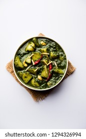 Aloo Palak sabzi / Spinach Potatoes curry served in a bowl. Popular Indian healthy recipe. Selective focus