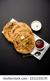 Aloo Paratha / Indian Potato stuffed Flatbread. Served with fresh curd and tomato ketchup. selective focus