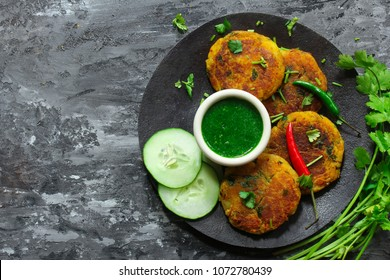 Aloo Tikki / Indian snack Potato Patties served with cilantro chutney