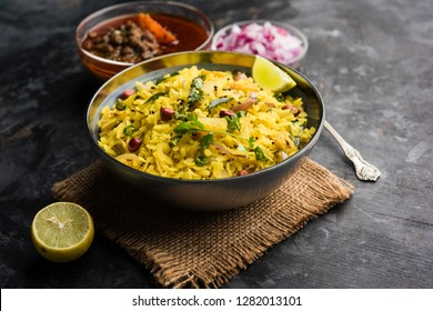 Aloo/Kanda Poha or Tarri Pohe with spicy chana masala/curry. selective focus