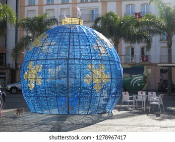 Alora, Spain - January 5, 2019: Large blue and gold walk through Christmas bauble in town square