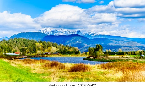 The Alouette River seen from the dyke at the Pitt Polder near Maple Ridge in British Columbia, Canada with the Golden Ears Mountain in the background