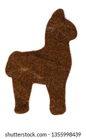 Alpaca or llama shape made of felted alpaca wool fiber isolated on white