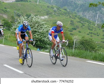 """ALPE D'HUEZ, FRANCE - JUN 12: Professional racing cyclists Estonia and France Champions ride UCI WORLD TOUR """" CRITERIUM DU DAUPHINE LIBERE"""" on June 12, 2010 in Alpe d'Huez pass, Isere, France."""