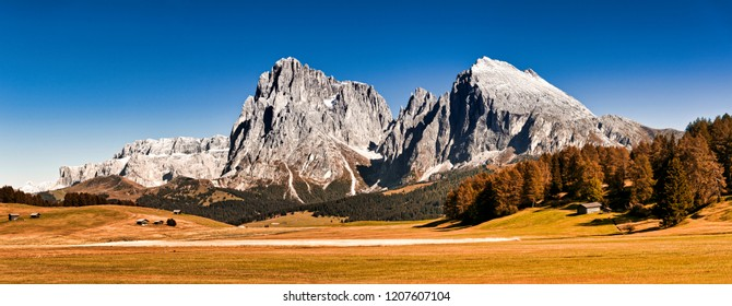 Alpe di Siusi plateau, great panorama with mountains of Sassolungo Group and clear blue sky at the horizon