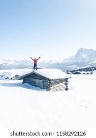 Alpe di Siusi at winter in Dolomites mountains, Italy.  A man looking at the beauty of winter Dolomites