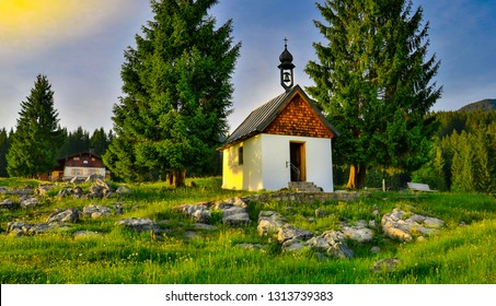 alpenglow alp sunset with little chapel on the rocks. mountain scenery at Reit im Winkl, Bavaria, Germany.travel hiking mountainclimbing