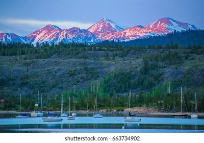 Alpenglow hitting the peaks of Grays and Torreys beyond the Frisco Bay Marina in Frisco, Colorado.